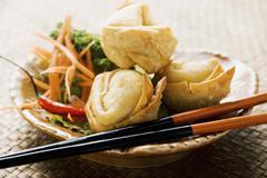 Deep-fried wontons with salad Stock Photos