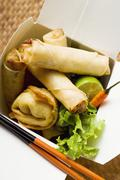 Deep-fried wontons and spring rolls to take away Stock Photos