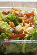 Salad leaves with vegetables, egg, cheese & bacon to take away Stock Photos