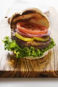 Home-made hamburger with gherkins, onions, tomato Stock Photos