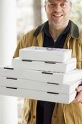Several pizzas being delivered Stock Photos
