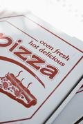 Pizzas in pizza boxes Stock Photos
