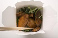 Chicken wings to take away Stock Photos
