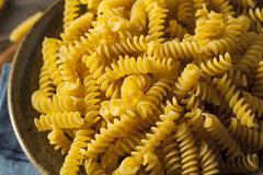 Raw Dry Organic Fusilli Pasta Stock Photos