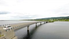 Aerial shot of car travelling over a bridge in Cape Breton Nova Scotia Stock Footage