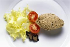Duck Liver Mousse with Truffles and Salad trimmings Stock Photos