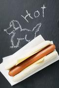 A hot dog on a blackboard (with drawing) Stock Photos