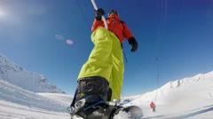 Snowboarding on a ski tow Stock Footage