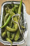 Pickled green chillies in aluminium tray Stock Photos