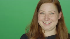Young redhead woman smiling and making silly faces Stock Footage