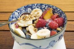 Muesli with berries and banana Stock Photos