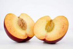 A halved nectarine Stock Photos