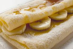 Crpes with bananas and maple syrup Stock Photos