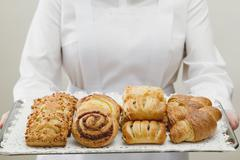 Assorted Danish pastries on a silver tray Kuvituskuvat