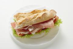 Sub sandwich with raw ham on a plate Stock Photos
