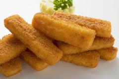 Fish fingers in a heap Stock Photos
