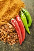 Chili peppers, chili flakes and chili powder Stock Photos