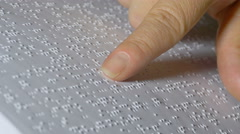 Female Hand Reading Braille Language On Book Stock Footage