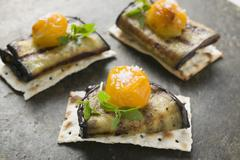 Crackers with grilled aubergines and cherry tomatoes Stock Photos