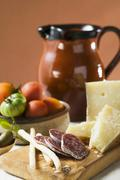 Still life with tomatoes, olives, salami, grissini, Parmesan Stock Photos