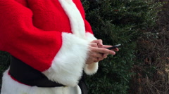 Santa online shopping on a smartphone Stock Footage