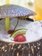 Pina Colada with cherries and lime (close-up) Stock Photos