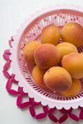 Apricots in plastic dish Stock Photos
