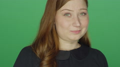 Young redhead woman smiling, on a green screen background Stock Footage