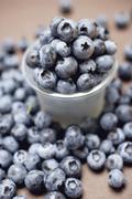 Blueberries with plastic beaker Stock Photos