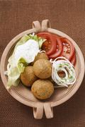 Falafel (chick-pea balls) with tomatoes and yoghurt dip Stock Photos