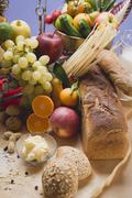 Fresh vegetables, fruit, butter, nuts and wholemeal bread Stock Photos
