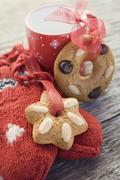 Gingerbread tree ornaments, cup and woollen mitten Stock Photos