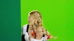 Woman in a bavarian costume shows thumb. Oktoberfest. Green screen Stock Footage