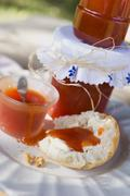 Rose hip jam in jars and on bread roll Stock Photos