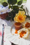 Rose hip jam on bread roll, yellow rose Stock Photos