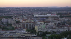 A view of rooftops and Prague from above during sunset in the summer. Stock Footage