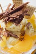 Fruity ice cream sundae with apricots & chocolate shavings Stock Photos