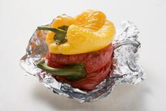 Grilled peppers on aluminium foil Stock Photos