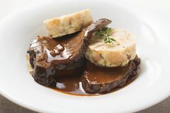 Roast beef with napkin dumpling Stock Photos