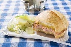 LeberkŠse in roll with mustard & potato salad on paper plate Stock Photos