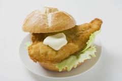 Breaded fish fillet and mayonnaise in bread roll Stock Photos