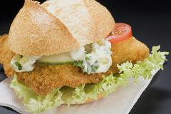Breaded escalope in a bread roll with remoulade Stock Photos