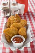 Chicken nuggets with ketchup in paper dish in snack bar Stock Photos
