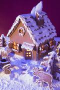 Gingerbread house with atmospheric lighting Stock Photos