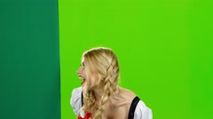 Girl in bavarian costume lures to their hand and showing the thumb. Green screen Stock Footage