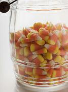 Candy corn (Halloween sweets, USA) in storage jar Stock Photos
