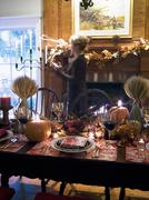 Table laid for Thanksgiving, woman in background (USA) Stock Photos