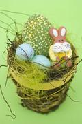 Easter sweets in Easter nest Stock Photos