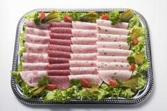 Attractively arranged cold cuts platter Stock Photos