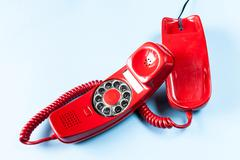 Old red phone off the hook Stock Photos